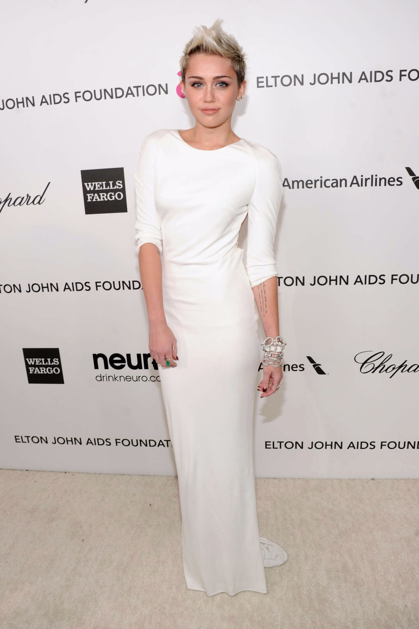 Miley Cyrus clad in a figure hugging white gown