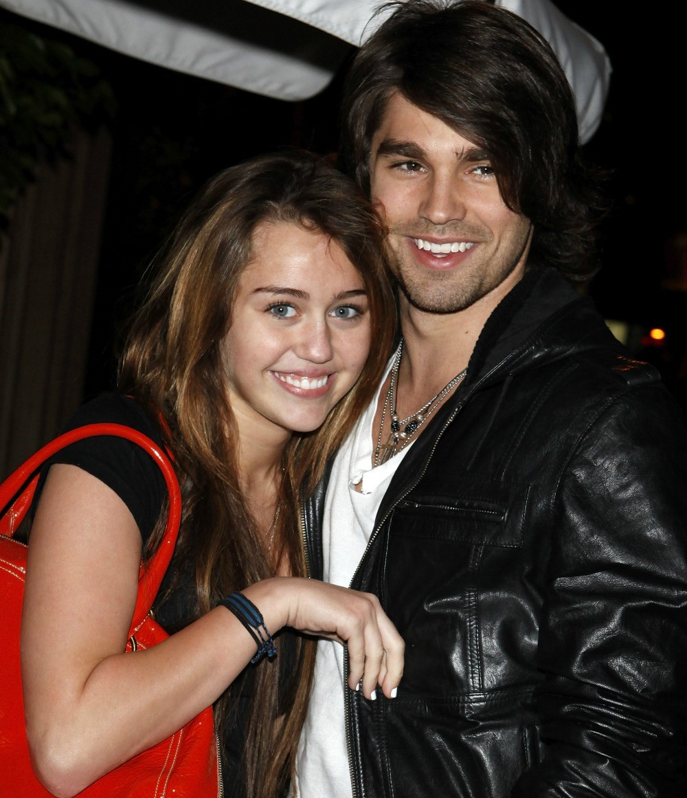 Miley Cyrus and Justin Gaston. Miley and Justin Gaston got together when she was just 15. Justin was five years older than Miley. He had competed on her father Billy Ray Cyrus's reality show, Nashville Star. Although the reason is unclear, the couple parted ways in 2009 and Miley left to film, The Last Song.
