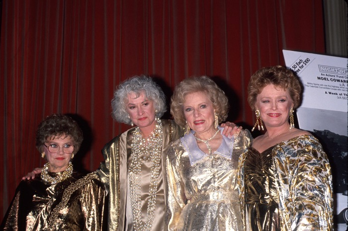 From left to right - Estelle Getty, Beatrice Arthur, Betty White and Rue McClanahan. All of them are wearing golden dresses.