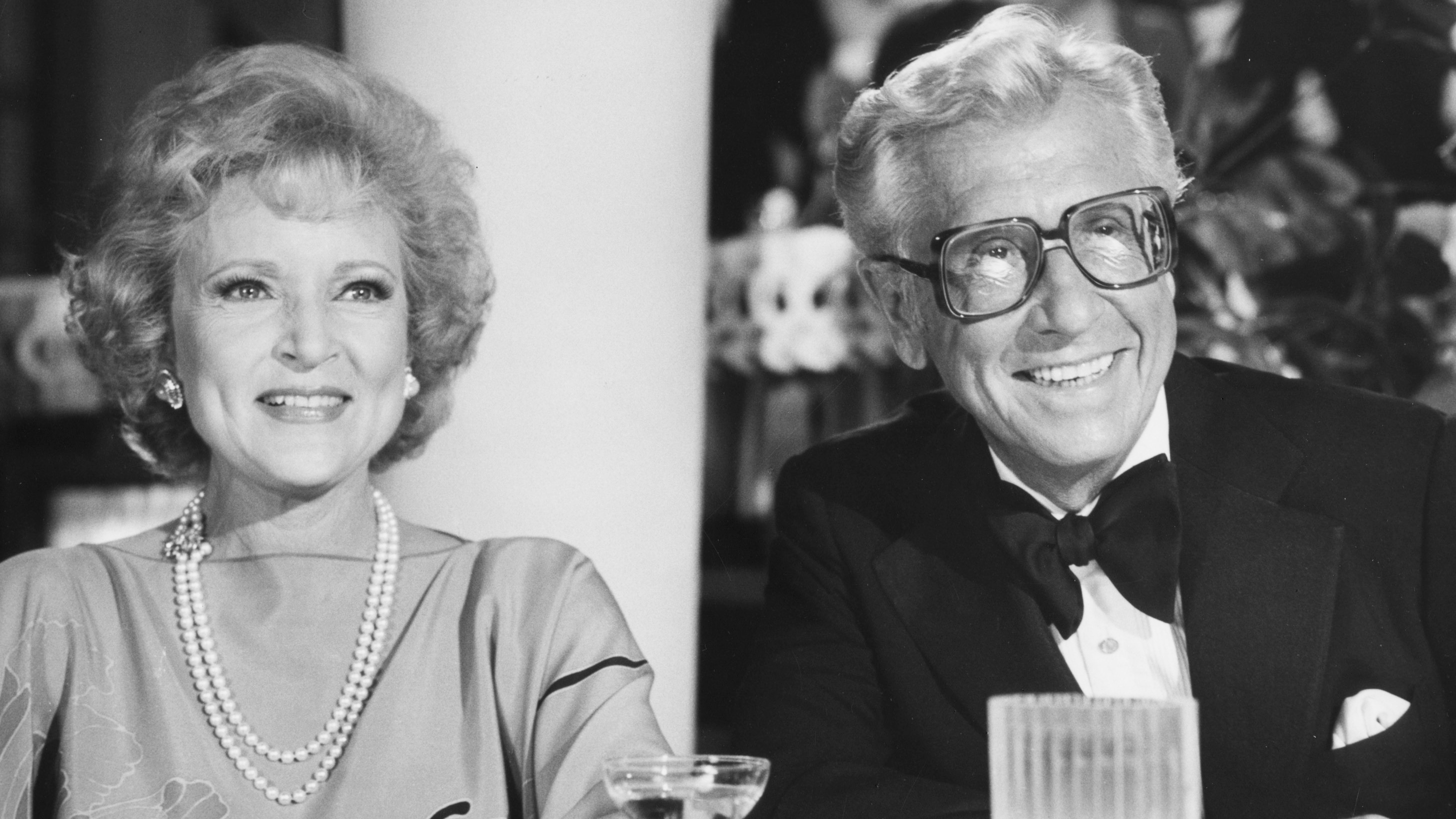 Black and White photo of Betty White with her husband Allen Ludden in a get together