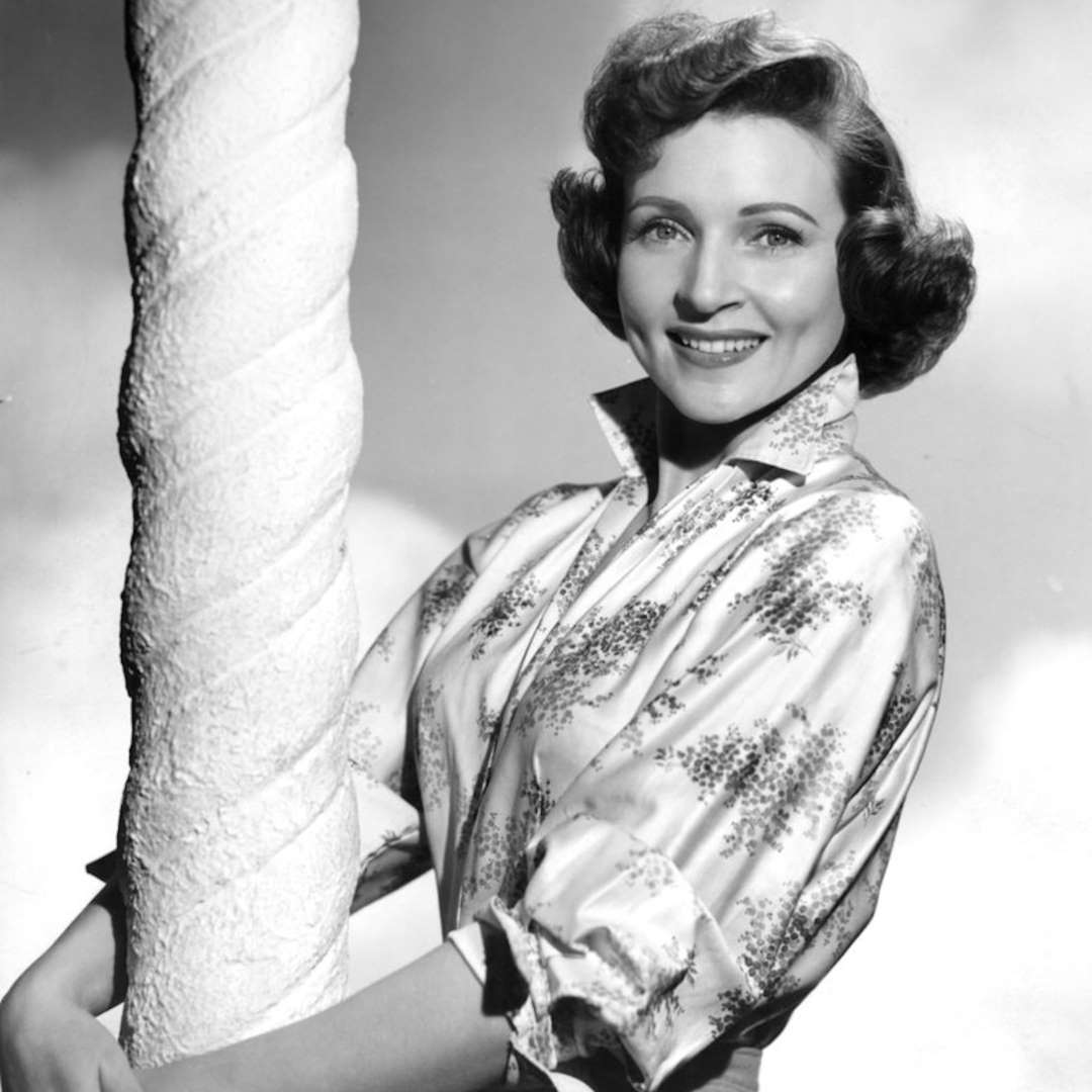 Black and White photo of Betty White holding a pillar