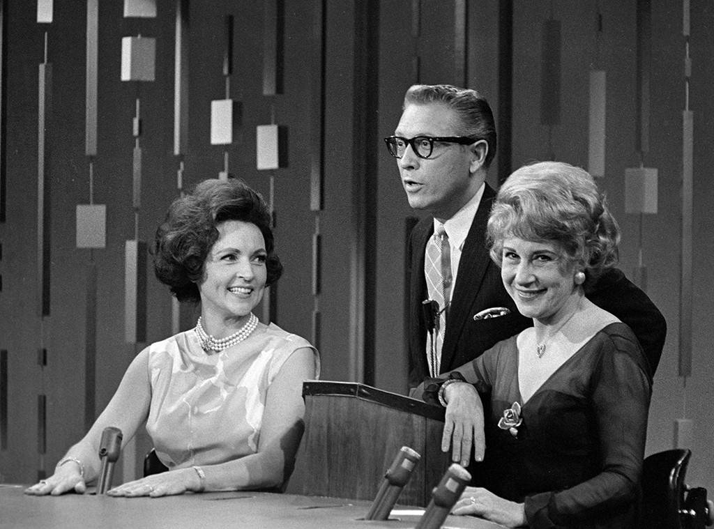 Betty White in her show Password with other two members. The photo is Black and White.