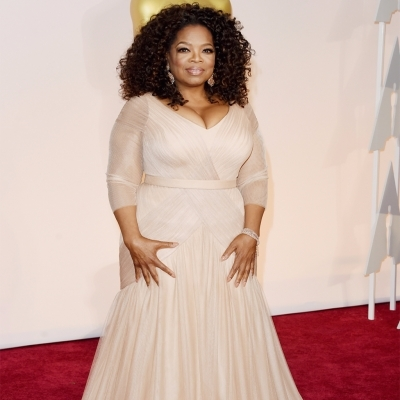 Oprah Gail Winfrey looks amazing in white gown