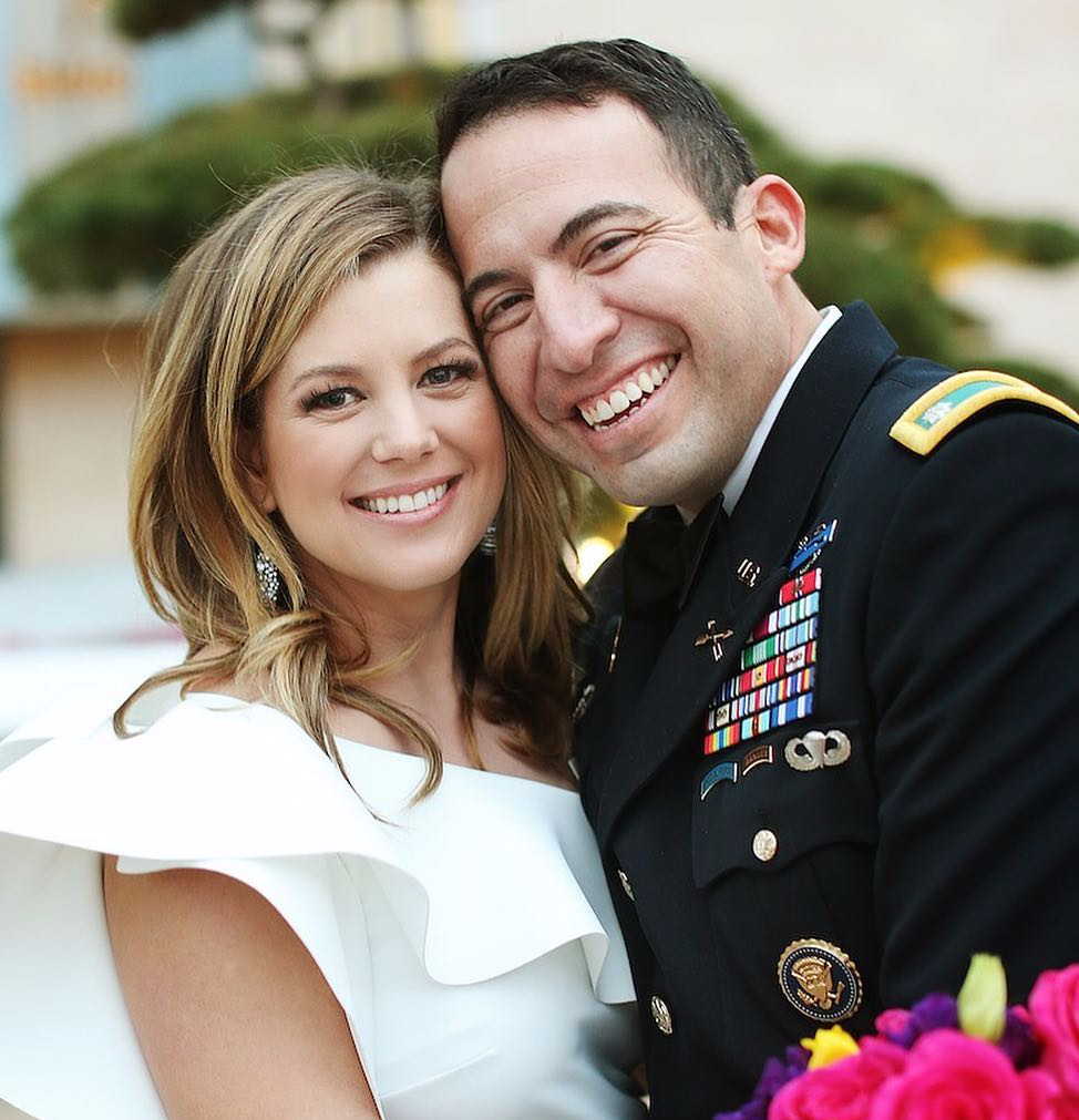 Brianna Keilar smiles for a picture in arms of her husband
