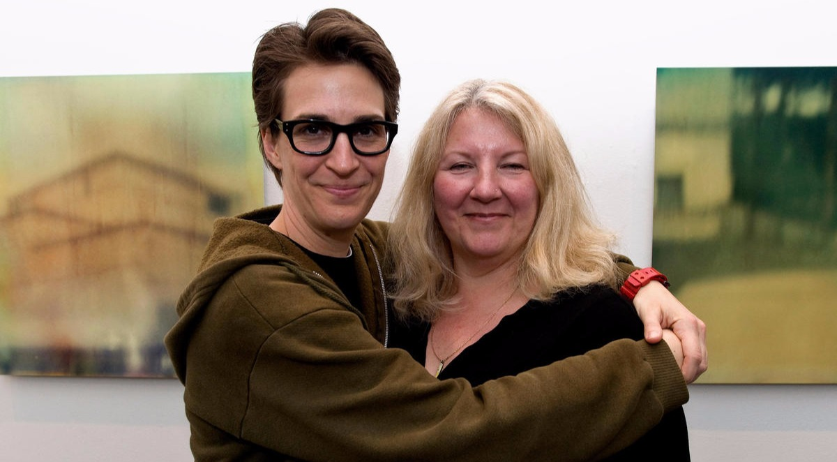 Rachel Maddow and Susan Mikula pose a smile as Rachel keeps her arms around Susan