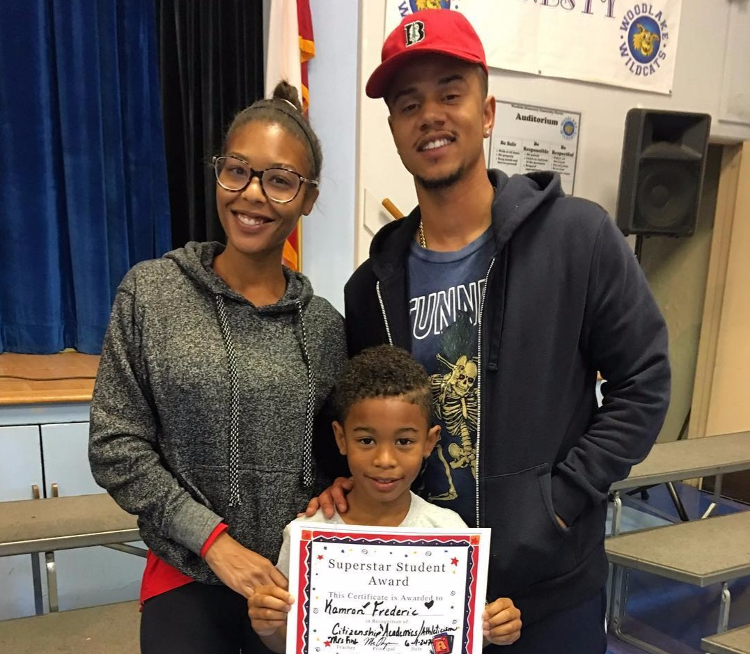 Moniece Slaughter standing next to her ex boyfriend Lil' Fizz and their son is holding a certificate