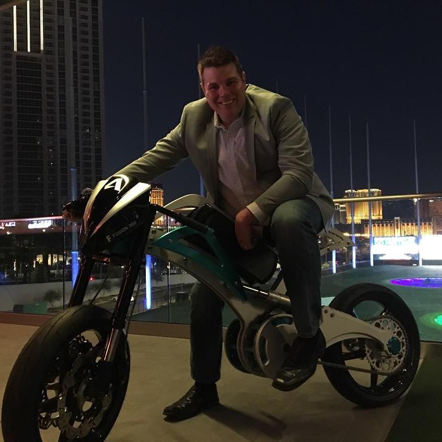 Jason Pohl is sitting in a bike
