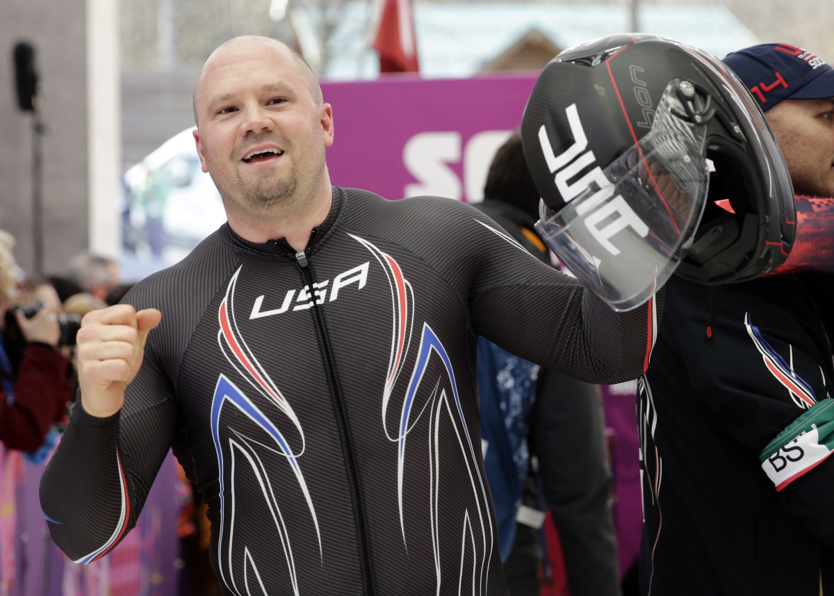 Steve Holcomb is holding helmet on his left hand