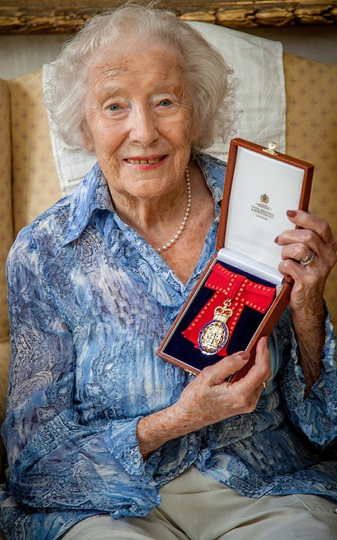 99 year old Vera shows her Order of the Companions medal
