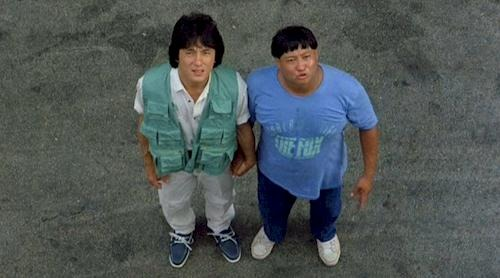 Sammo Hung with his co-actor Jackie Chan's surprising face for the camera. The two appeared together in the movies Heart of Dragon.