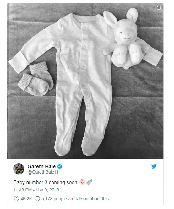 Gareth Bale sharing picture of white babygrow along with tiny pair of socks and a bunny