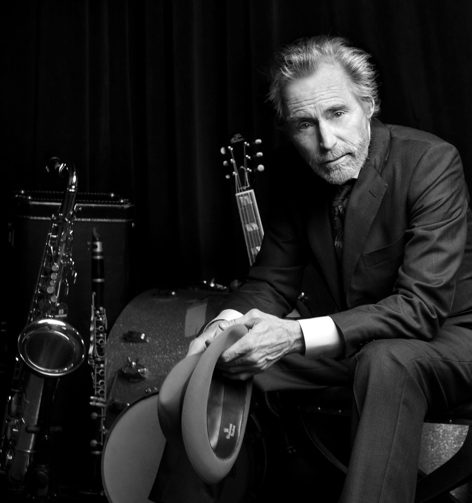 JD Souther giving an iconic look besides drums, guitars and other musical instruments
