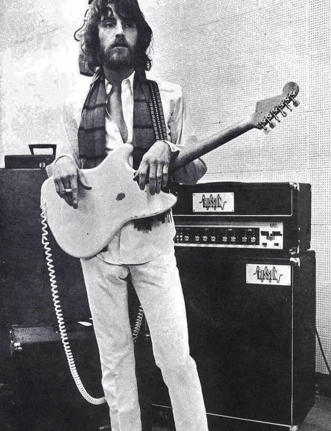 J.D. Souther posing with his guitar and a cigarette