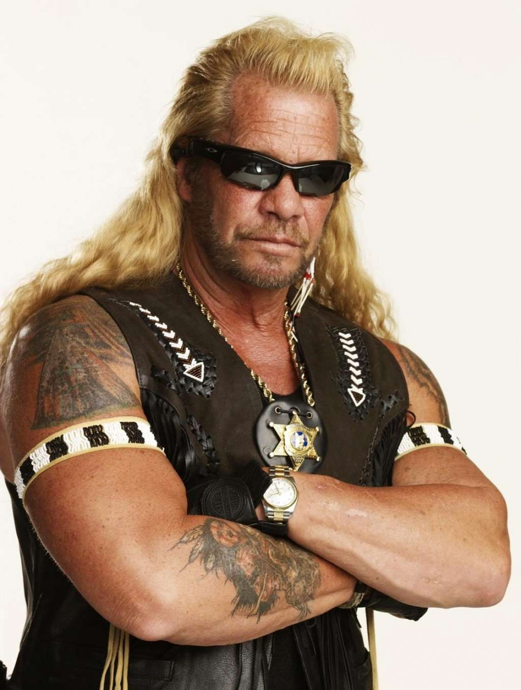 Duane Chapman posing for a photo in his signature out fit