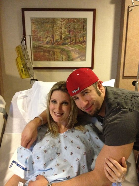 Gregory Helms is embracing his girlfriend Karen who is lying on a hospital bed.