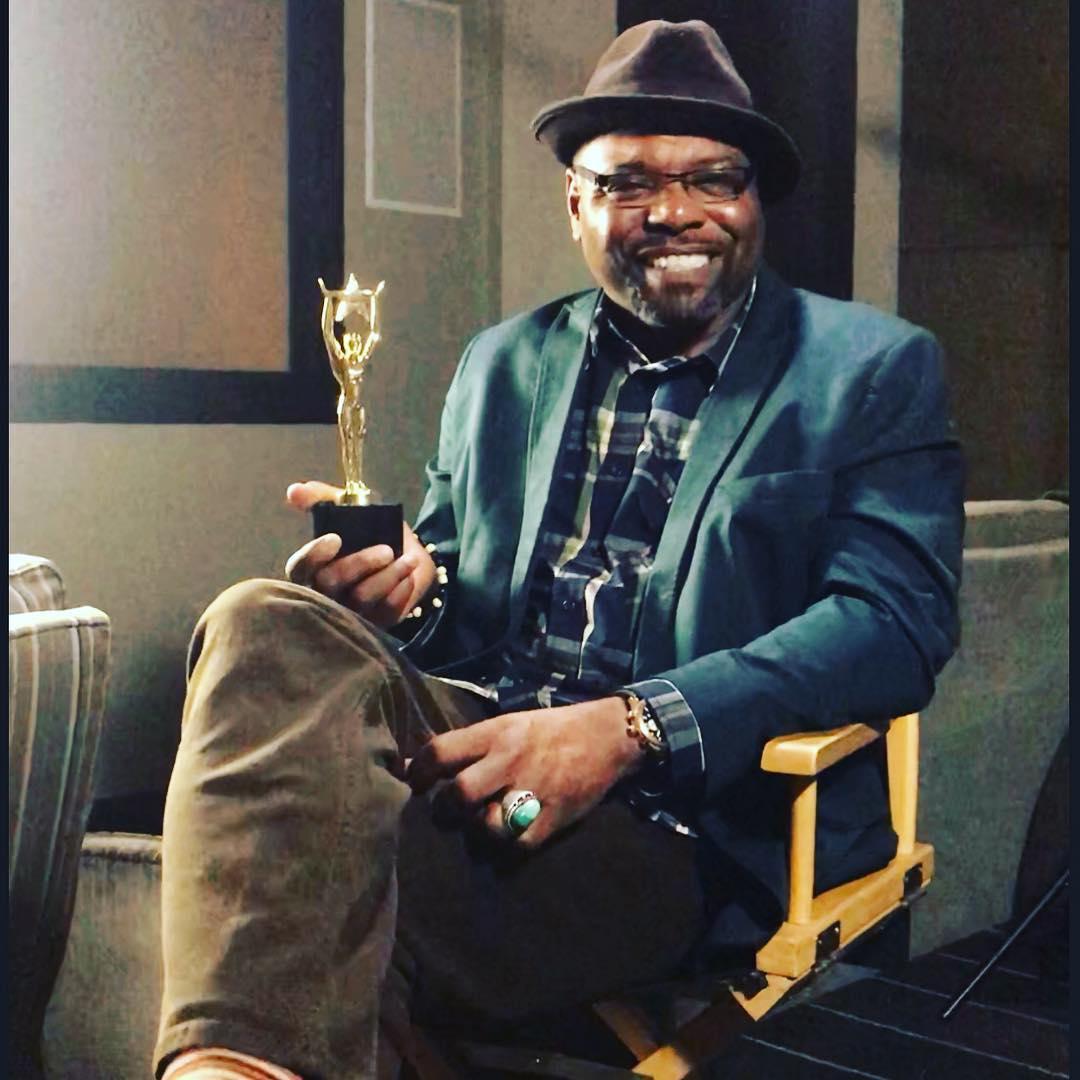 Byrd holding an award