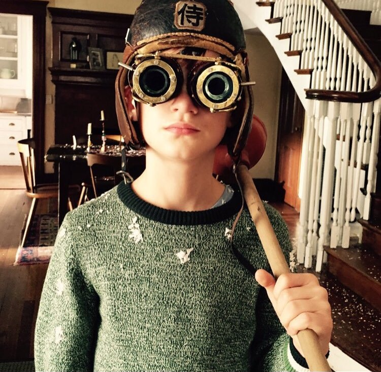 Jaeden Lieberher from the set of The Book of Henry. He has put on a helmet with a fancy visor.