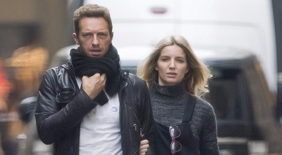Annabelle Wallis arm in arm with Chris Martin