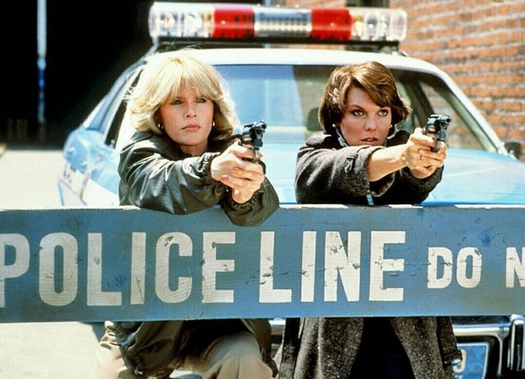 Sharon Gless with her co-star Tyne Daly. It's a scene from their show where they both are pointing guns at their opponent.