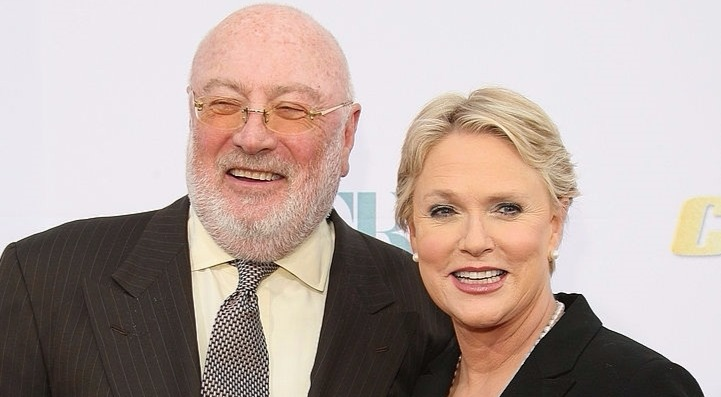 Sharon Gless standing close to her husband Barney Rosenzweig. They are both smiling.