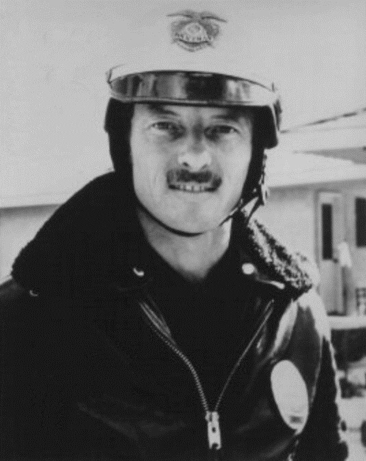 Ken on a uniform of Highway Patrol