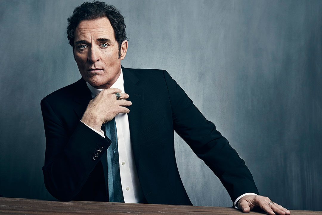 Kim Coates looks total clad in the black suit and white shirt