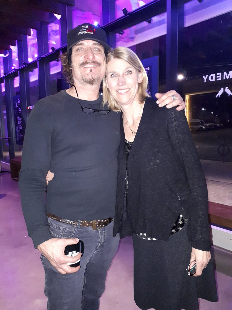 Kim Coates and his wife, Diana smiles wrapping their hands around each other