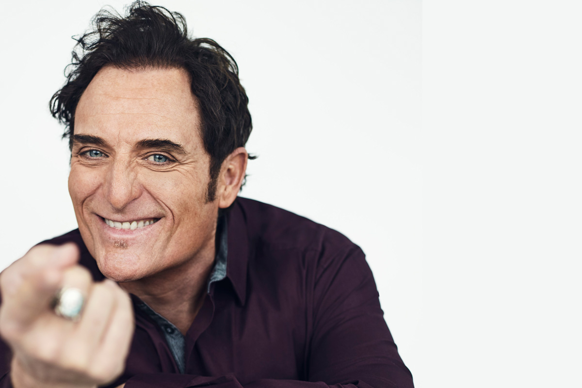 Kim Coates poses with a smile on his face