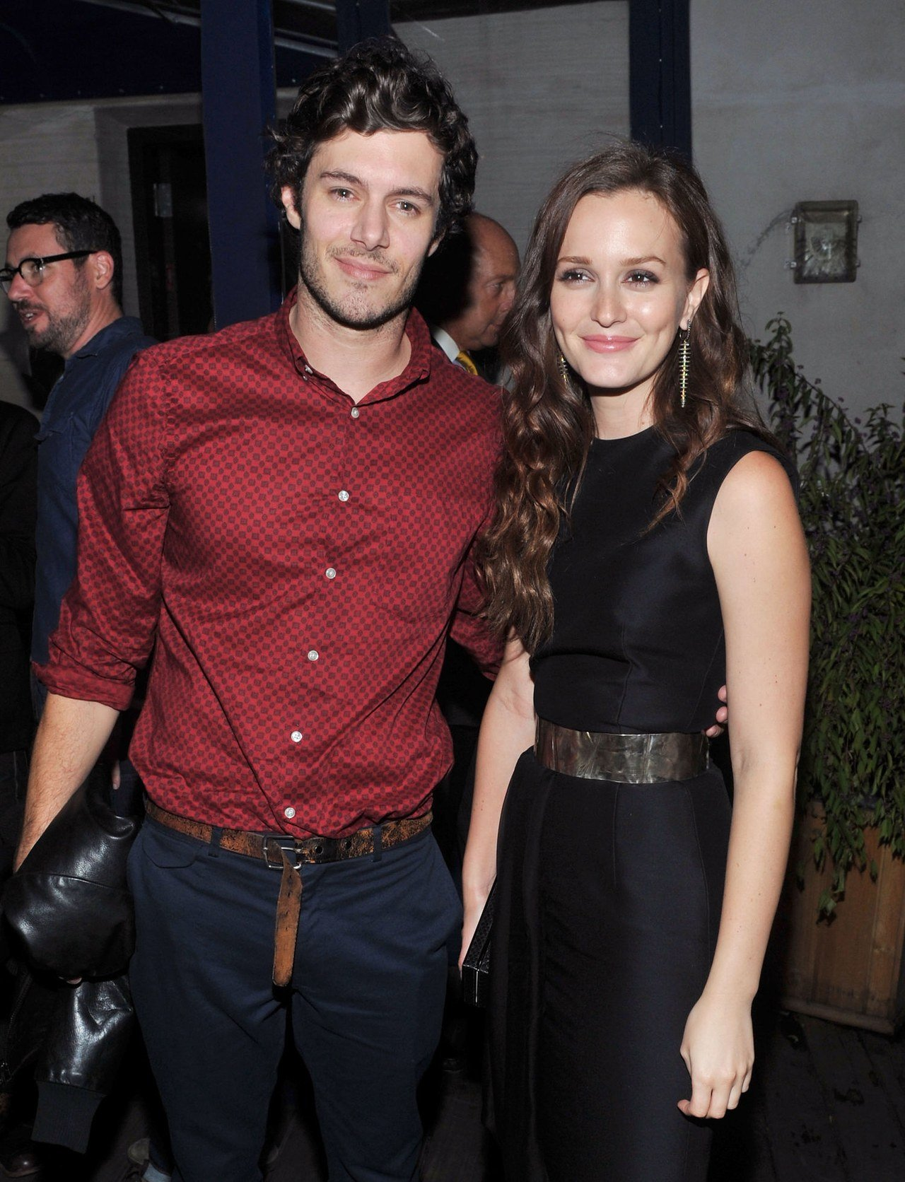 Adam Brody wraping his one hand around his wife, Leighton Meester's waist