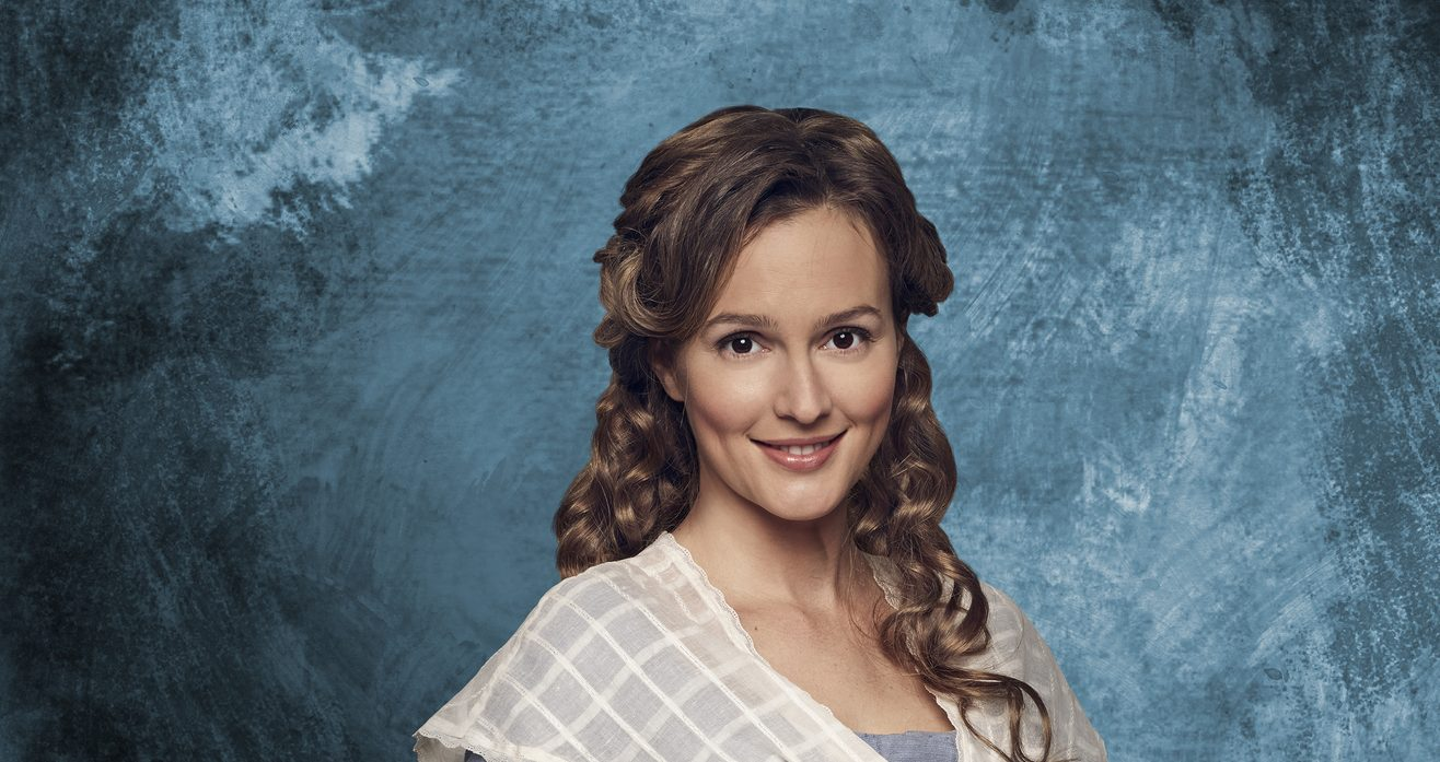 Leighton Meester with a subtle smile on her face and curly golden blonde hair