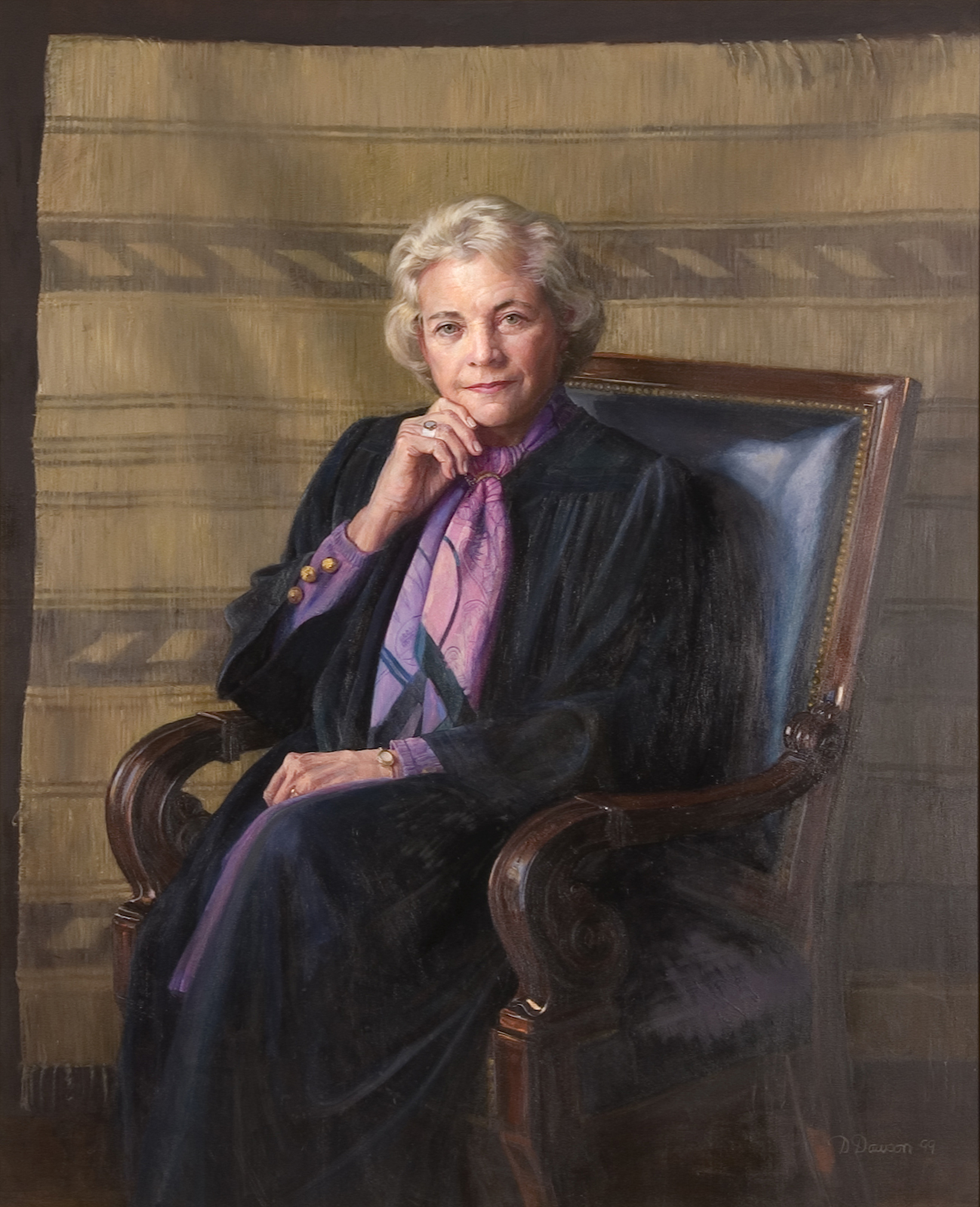Sandra Day O'Connor sitting on the chair. She is wearing a dress of judge.