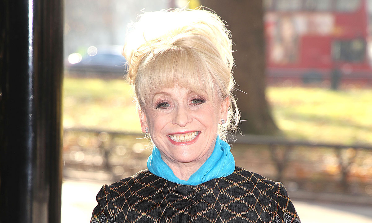Barbara Windsor smiling. She is  wearing a blue scarf around her neck.