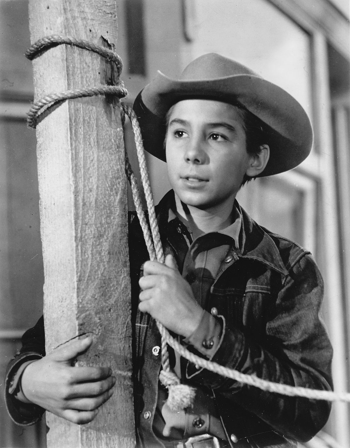 Black and white image of Johnny Crawford from the show The Rifleman