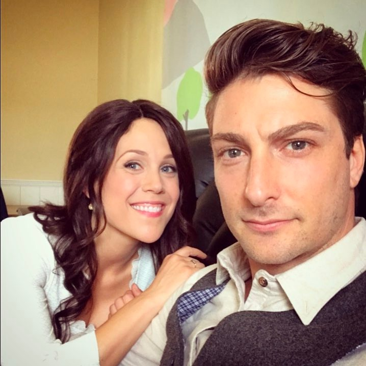 Daniel Lissing and Erin Krakow are sitting next to each other
