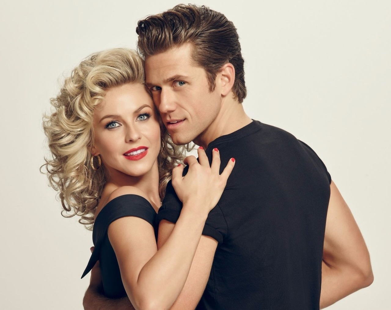 Aaron Tveit in an embrace with Grease co-star Julianne Hough