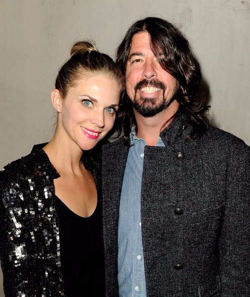 Jordyn Blum and husband Dave Grohl look like they are in a jolly mood. They have put on a stylish look with Jordyn's glittery black outer and Dave's classy coat.
