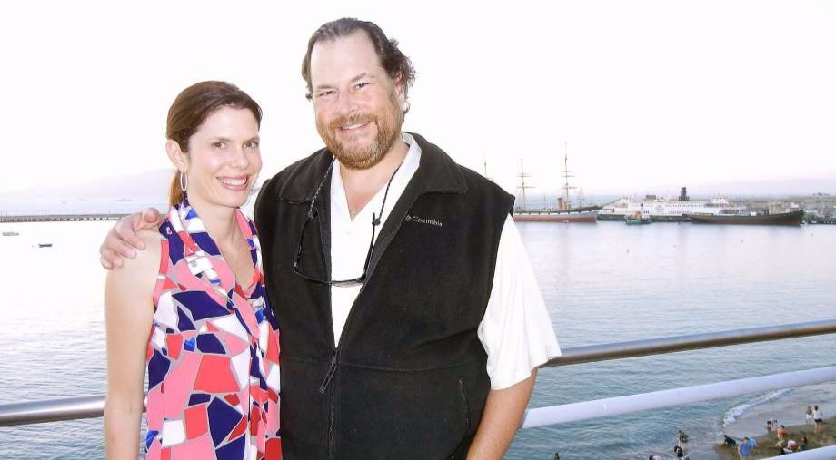 Marc Benioff and wife, Lynne Benioff standing in the beach