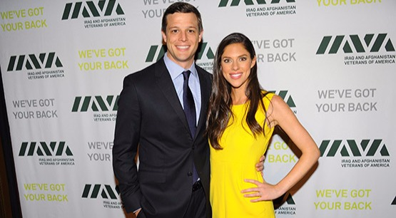 Abby Huntsman and her husband Jeffrey Bruce Livingston are at a public event. Abby is wearing a yellow dress and Jeffrey is in a black suit.