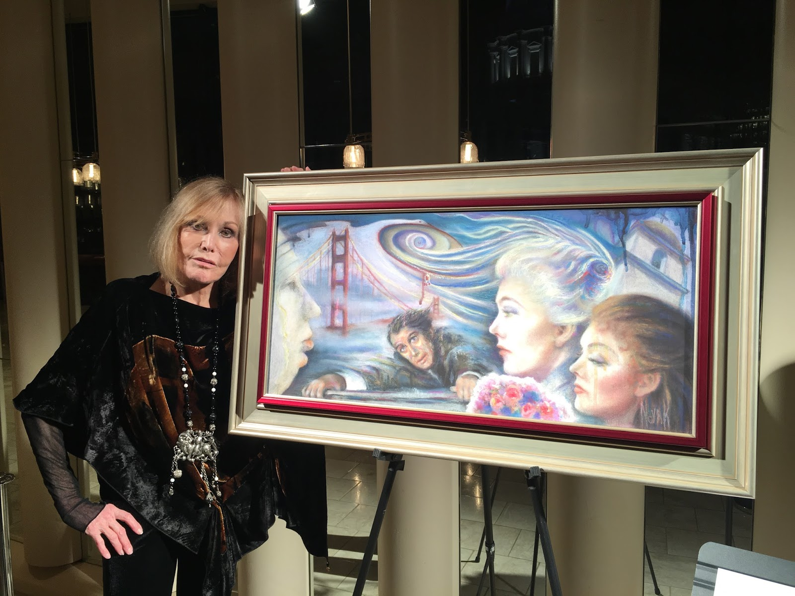 Kim Novak with her painting in a gallery