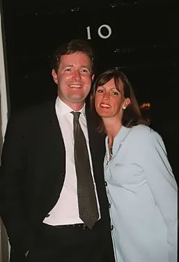 Marion Shalloe standing close to her then husband Piers Morgan. They are both smiling.