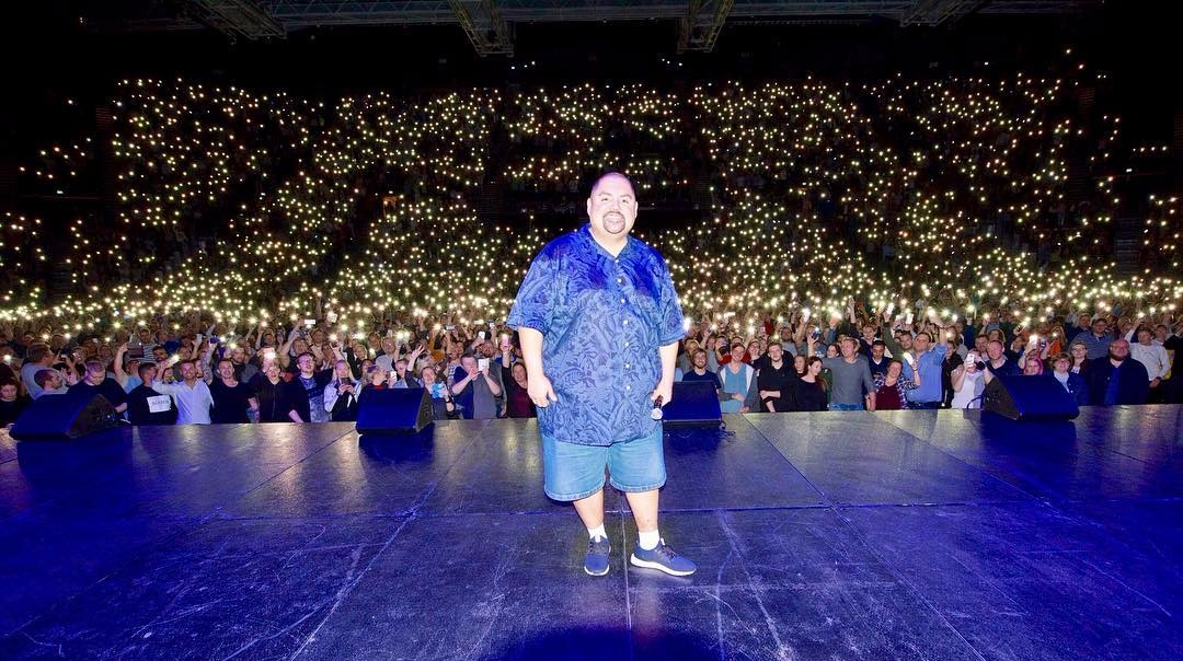 Gabriel Iglesias on the stage, standing in front of his audience