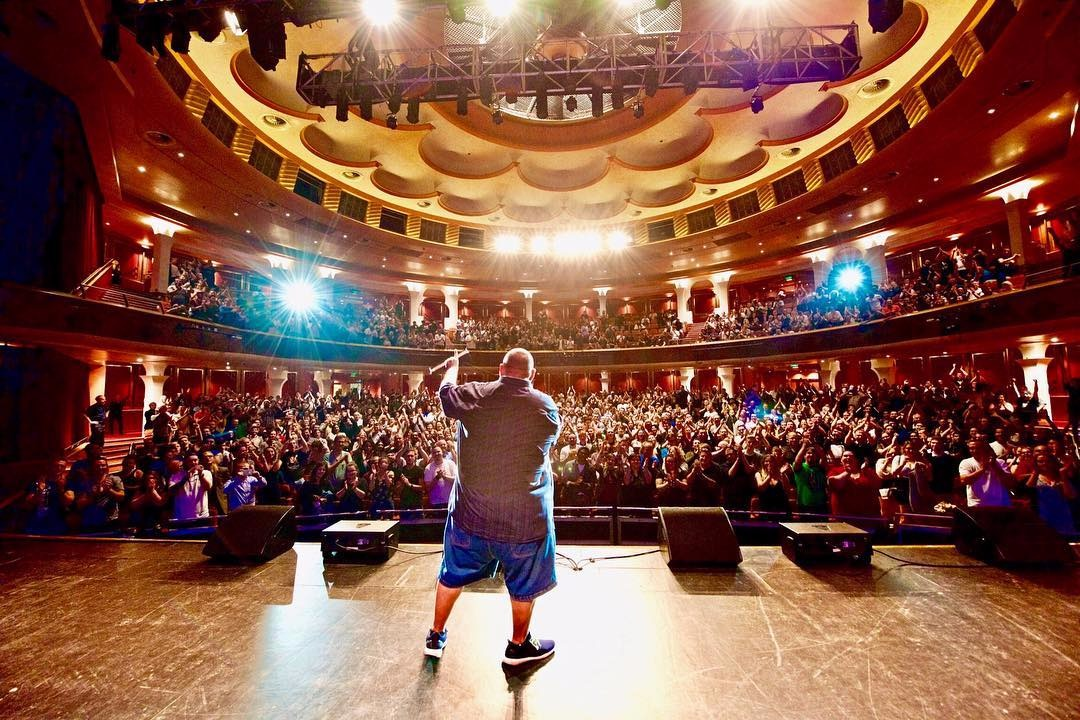 Gabriel Iglesias entertaining thousand of people during a tour event