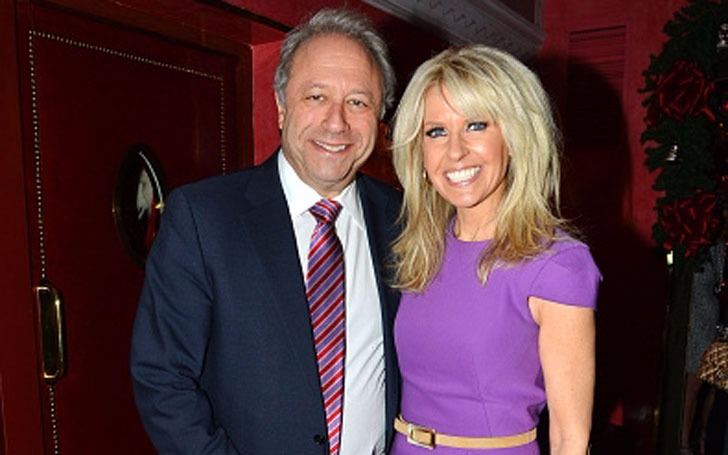 Monica Crowley and Bill Seigel stand close to each other. They are both smiling in the picture.