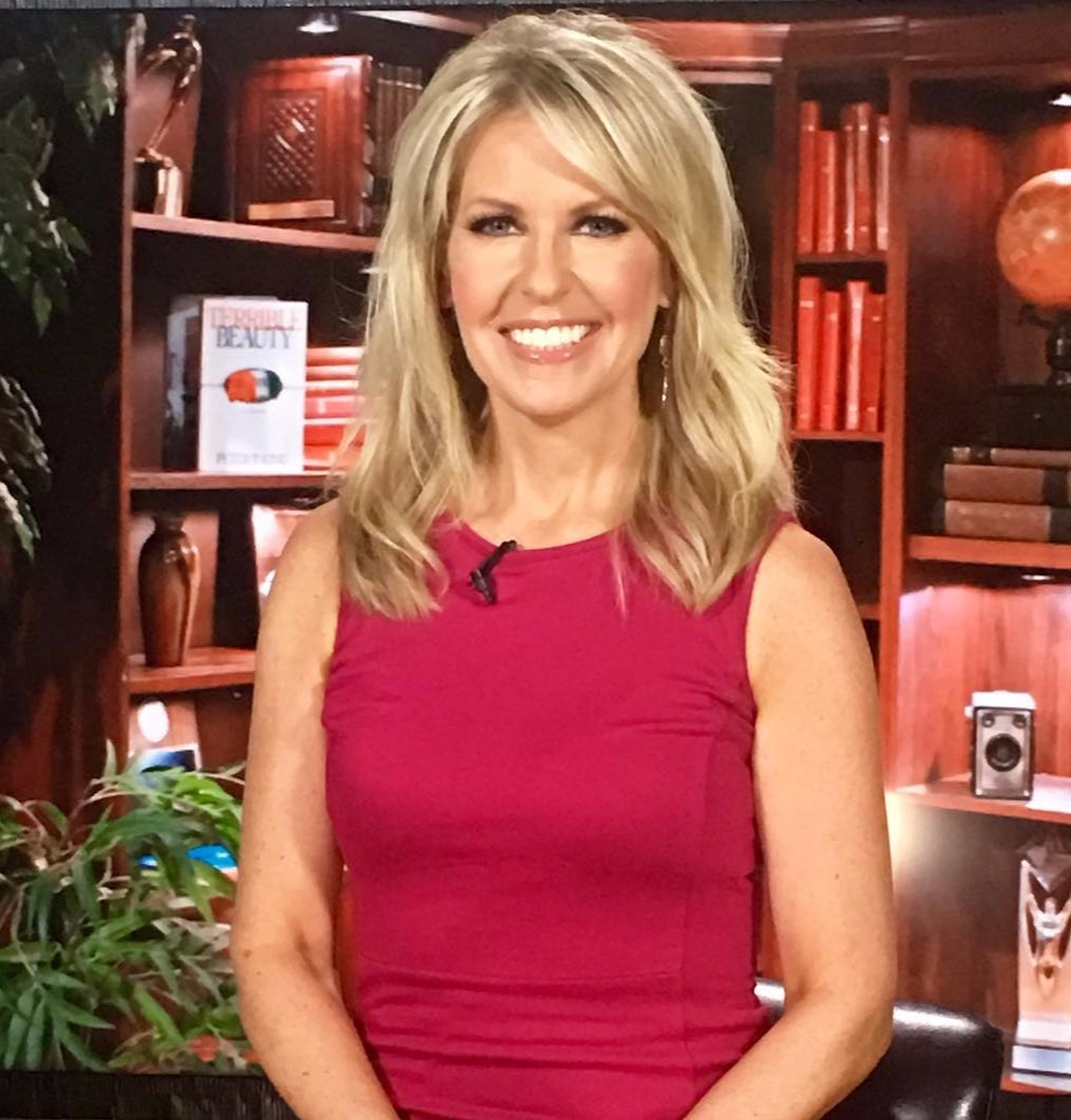 Fox News' analyst Monica Crowley wearing a smile.