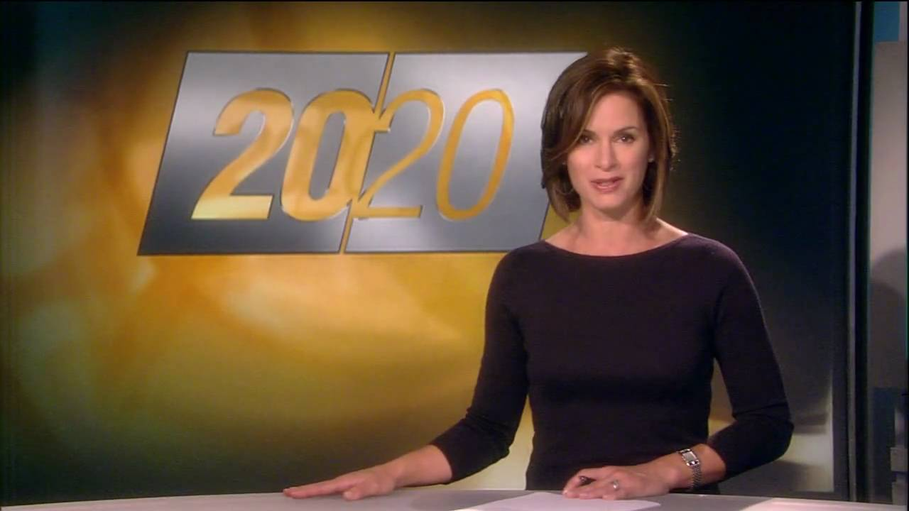 Elizabeth Vargas reporting the news from the set of 20/20. The screen behind her displays a logo of 20/20.