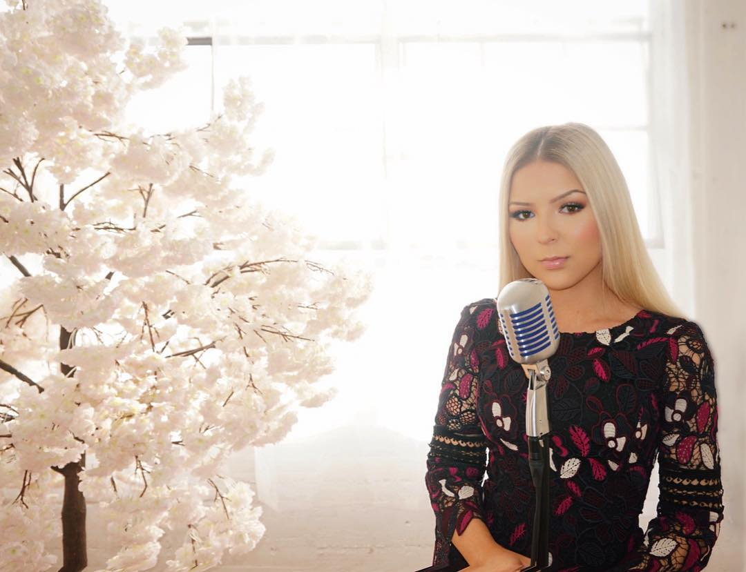 Bianca Ryan is wearing a floral dress