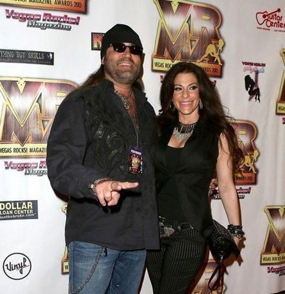 Counting Star Danny Koker is with his wife Korie Koker. He has crossed his arms around his wife's waiste. Both seems to be happy as they are smiling on camera. They both are wearing black and look stylish in their outfit.