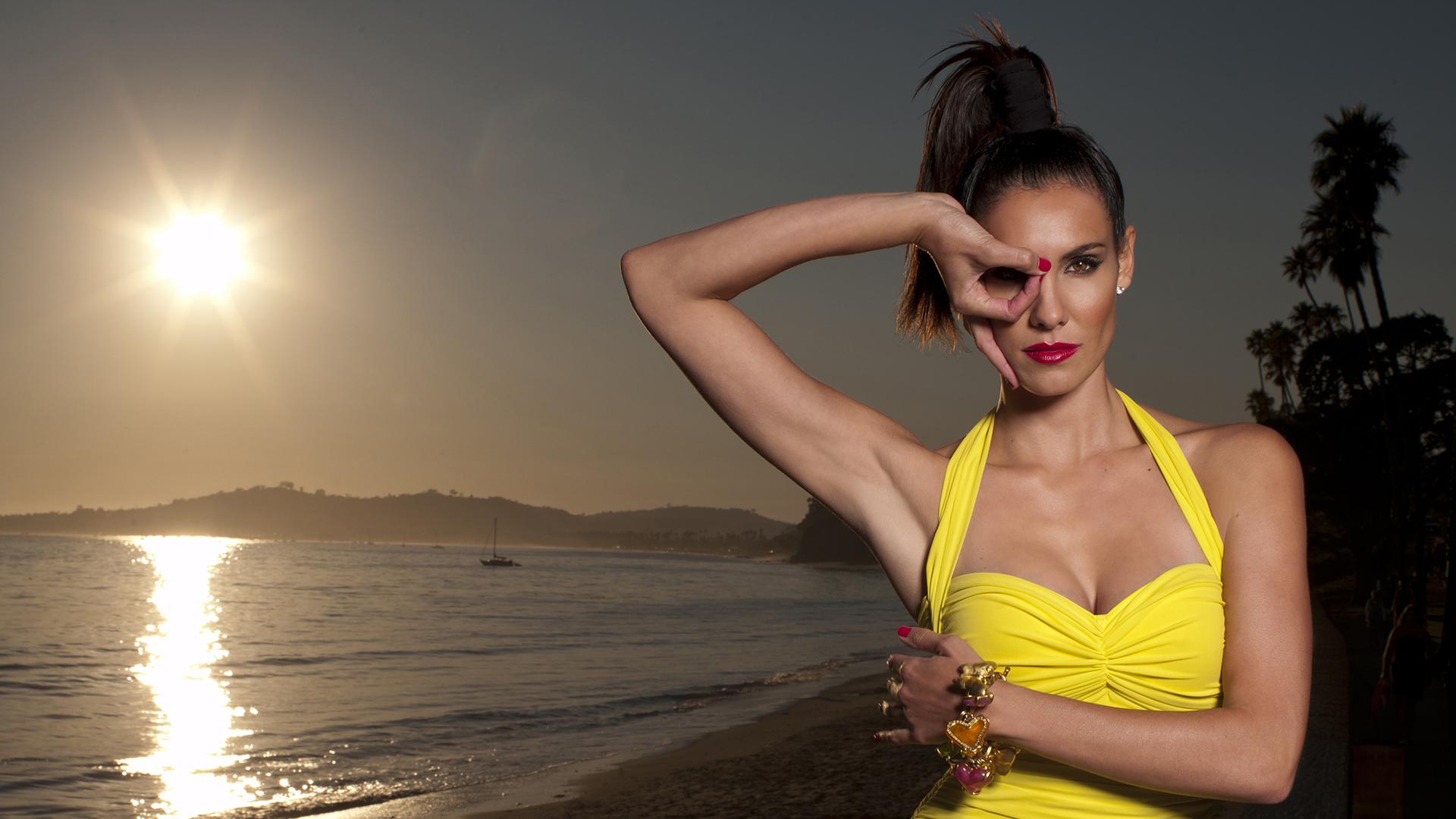 Daniela Ruah is having a photo shoot at the beach. She looks stunning on her yellow swim wear.