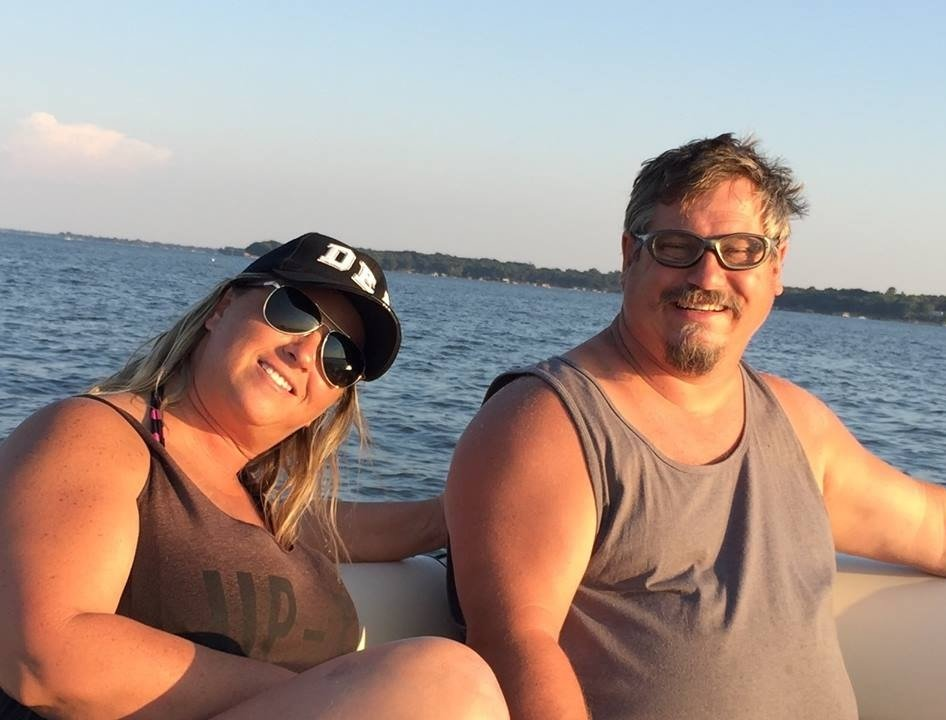 Tom Smith is enjoying boating with his wife Deanna Pepper Whetshell. His wife Deanna is wearing black goggles and a cap.