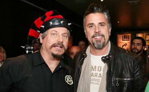 Tom Smith is standing next to Richard Rawlings. Tom is wearing red ann black striped cap.